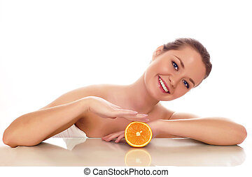 young beautiful woman with orange - isolated