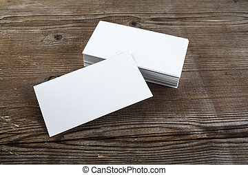 Business cards - Photo of blank business cards on a wooden...