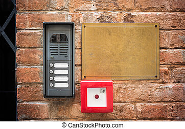Entryphone on brick wall, close up view - Entryphone on...