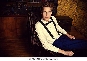 nobleman - Elegant handsome young man sitting by the...