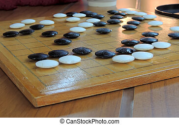 Game Go - Board game Go or Weiqi; or way-chee; or Igo; or...