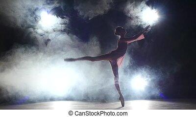 Pretty bellet dancer dancing at studio. silhouette. slow...