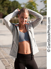 Late afternoon workout. - Beautiful athletic blond woman's...