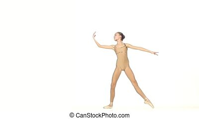 Young balet dancer isolated on white background. slow motion