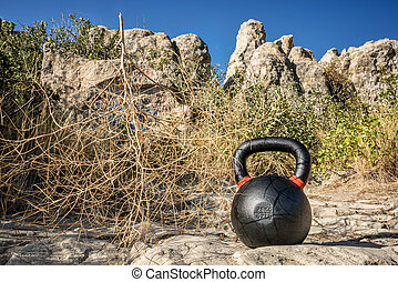 heavy iron kettlebell with tumbelweed - outdoor fitness...