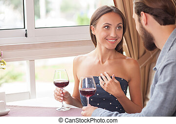 Cheerful man and woman are resting in cafe - Attractive...