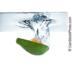 avocado falling into water - cut avocado falling into water...