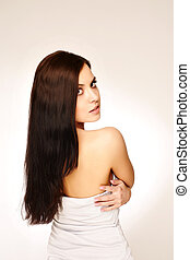 young woman portrait with lomg hair, studio shoot