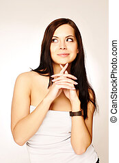 Girl looking at blank space - Close up portrait of a beautiful female model. Looking to the side into copyspace