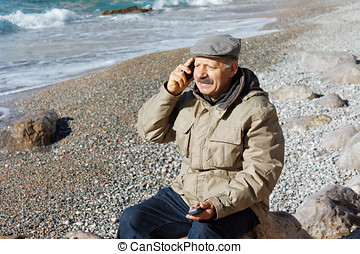 Senior man talking by mobile phone