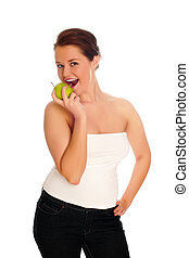 Young woman eating apple and smile over white background