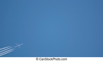 Flying high - Contrails in the blue sky Airbus 340 flying...