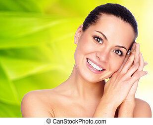 portrait of a young beautiful brunettes with perfect skin and a smile