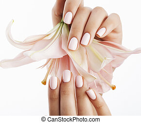 beauty delicate hands with manicure holding flower lily...