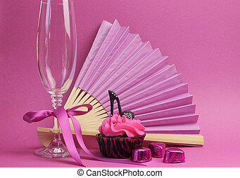 Pink party cupcake with black stilleto high heel shoe with...
