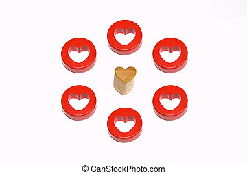 Spoilt for choice - single wooden heart surrounded by six...