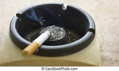 cigarette in ashtray slow motion