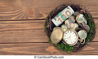 Watches, money, and eggs in a nest