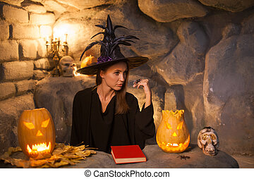 Attractive female wizard is celebrating Nut-Crack Night -...
