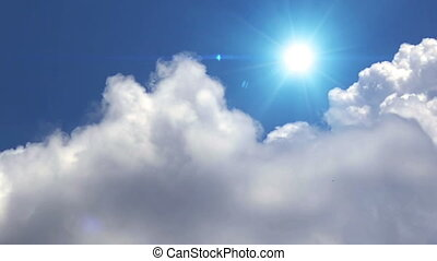 Great white clouds with sun over the clean deep blue sky...