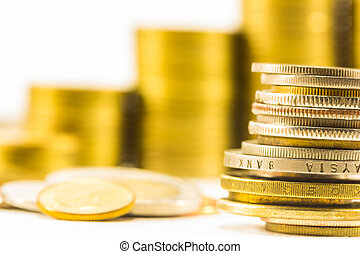 golden coins and coins stacked on each other in different...