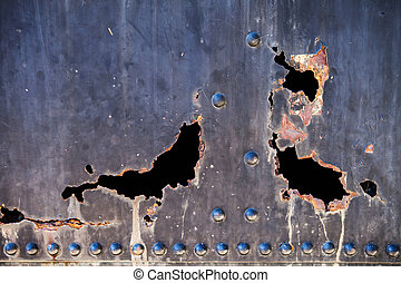 Metal with rusty hole and flaking paint - Background of...