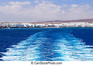 Ferry boat water trail left over the sea at Lanzarote,...