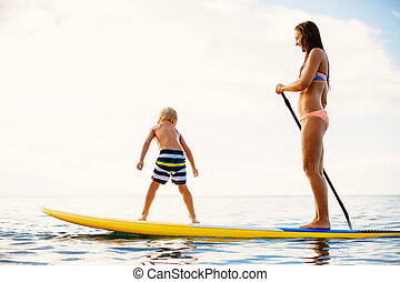 Mother and Son Stand Up Paddling Together Having Fun in the...