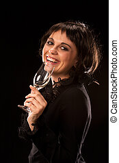 Young female brunette drinking wine and laughing