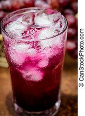 grape juice - Red grape juice on wooden