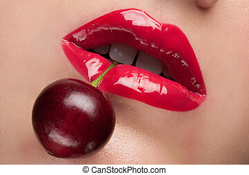 Red lips with a cherry.