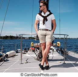 Stylish trendy man on a regatta