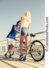 Man flirting with woman outdoors