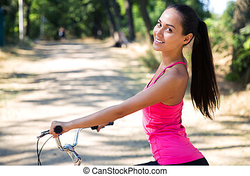 Woman riding on bicycle in park