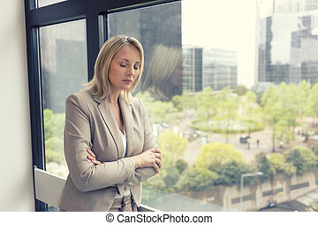 Depressed business woman at the office - Businesswoman,...