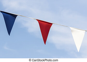 Close up of red white and blue triangular bunting