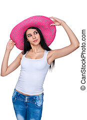Casual woman in pink straw hat - Playful casual girl in...