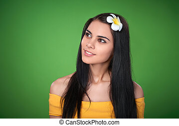 Teen female with Plumeria Flower - Closeup portrait of...