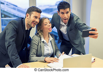 Selfie business team taking pictures in the office. Their...