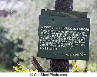 Anti song bird hunting notice - Hunting songbirds such as...