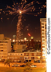 Christmas Fireworks celebration over the city. - Night scene...