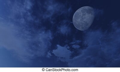 Cloudy night sky with a half moon