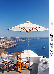 Romantic Sunspot Santorini - Romantic patio with table and...