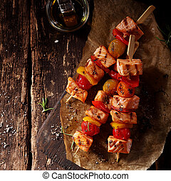 Top View of Three Fish Kebabs on Table with Oil - Top View...