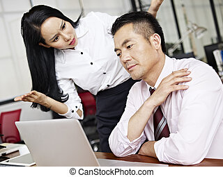 baffled asian businesswoman - businesswoman puzzled and...