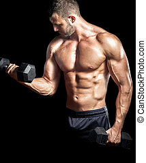 Man doing biceps curls in gym. - Young adult man doing...