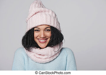 Laughing mixed race winter woman