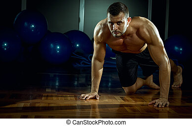 Man doing push-ups in gym