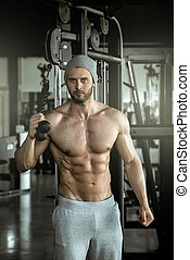 Man doing rope extension exercise - Young adult bodybuilder...