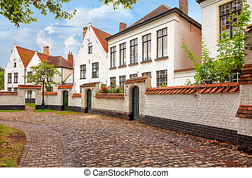 Bruges historical pitched roofs of Begijnhof - Traditional...